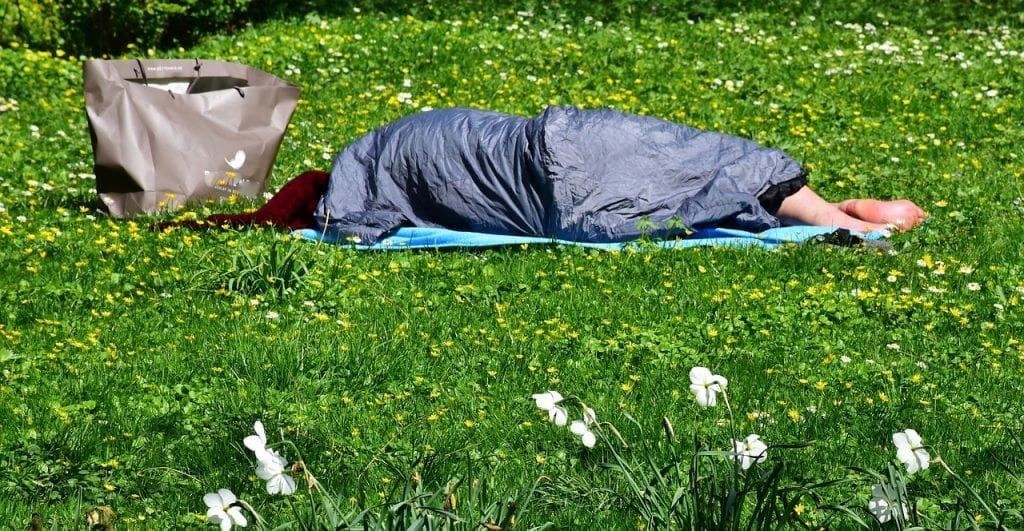 homeless man sleeping in the park